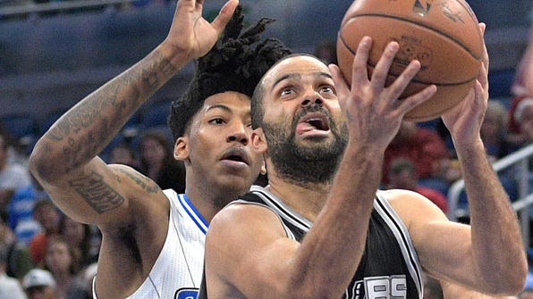 San Antonio Spurs guard Tony Parker looks for a shot in front of Orlando Magic guard Elfrid Payton during the first half of an NBA basketball game in Orlando, Fla., Wednesday, Feb. 15, 2017. (AP Photo/Phelan M. Ebenhack)