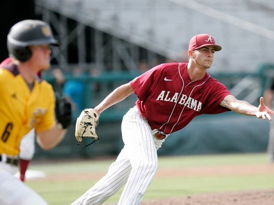 Alabama's pitcher, Taylor Guilbeau tosses over to first to force out Kennesaw State's Jacob Bruce in the third inning of an NCAA regional college baseball game on Sunday,  June 1, 2014, in Tallahassee, Fla. (AP Photo/Steve Cannon)