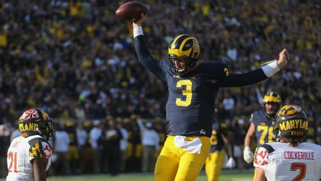 Michigan Wolverines quarterback Wilton Speight scores a touchdown against the Maryland Terrapins on Nov. 5, 2016 at Michigan Stadium.
