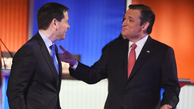 Sen. Marco Rubio, R-Fla., speaks with Sen. Ted Cruz, R-Texas, during a break at the Fox Business Network Republican presidential debate at the North Charleston Coliseum on Jan. 14, 2016.