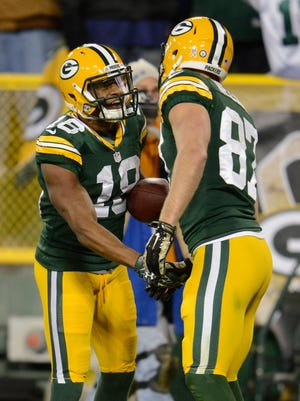 Green Bay Packers receiver Jordy Nelson (87) shakes hands with Randall Cobb (18) in the end zone after Nelson scored a touchdown in the second quarter against the Chicago Bears.