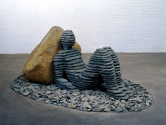 Boaz Vaadia's  'Ahiam 2nd' is a 2006 bronze, boulder and bluestone work.