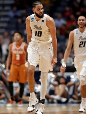 Nevada forward Caleb Martin (10) reacts after sinking a basket in overtime of a first-round game against Texas.