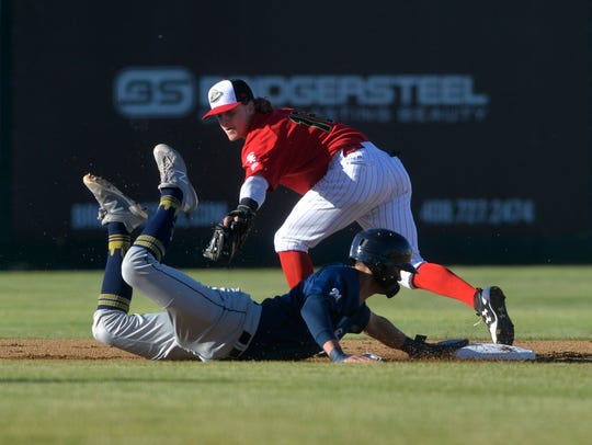 Voyagers second baseman Travis Moniot attempts to tag