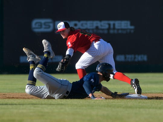 Voyagers second baseman Travis Moniot attempts to tag out Helena baserunner Chad McClanahan during Friday's home opener Centene Stadium.
