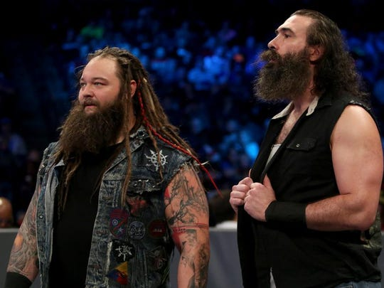 Bray Wyatt (left) won his first championship in WWE — the SmackDown Tag Team Championship with Randy Orton (not pictured) — last year. The pair are on the card for the WWE bouts Tuesday, Jan. 31, 2017, at the American Bank Center Arena. Luke Harper (right) also is on Tuesday's fight card.