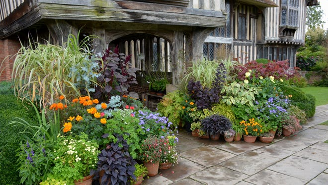 More than 50 plant-filled pots make an extravagant display at the doorway of Great Dixter.