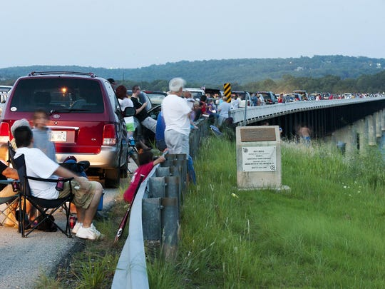 Folks wait on the U.S. Highway 62 Veterans Memorial Bridge for the Independence Eve Fireworks Show in this 2008 file photograph. The event is celebrating its 30th anniversary this year.