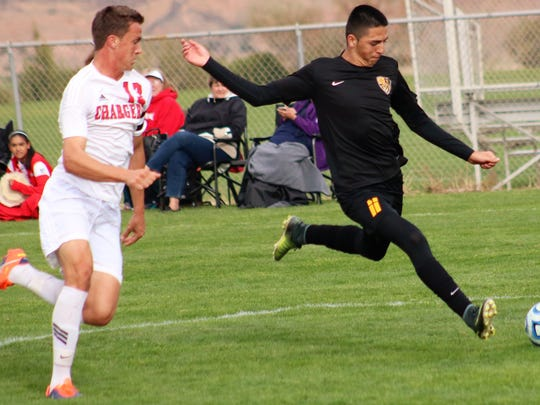 Alamogordo's Julian Torres takes a shot at the goal in the first half.