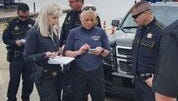 Bossier Sheriff's officers discuss the recovery effort of a body found in the Red River