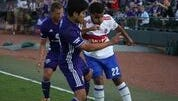 Louisville City's Oscar Jimenez and Toronto FC II's Jordan Hamilton fight for control of the ball during Saturday's game on April 29, 2017