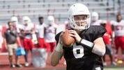 Austin Peay quarterback Jeremiah Oatsvall attempts a pass.