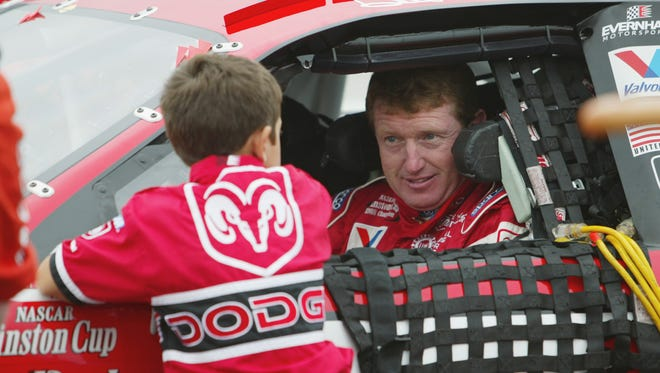Bill Elliott talks with six-year-old son Chase during a 2002 NASCAR race at Pocono Raceway. Bill Elliott's nephew Casey died at age 21 on Jan. 14, 1996, two months after Chase was born.
