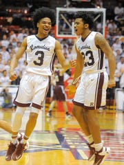 Darius Lundy, left, who made the winning basket, starts