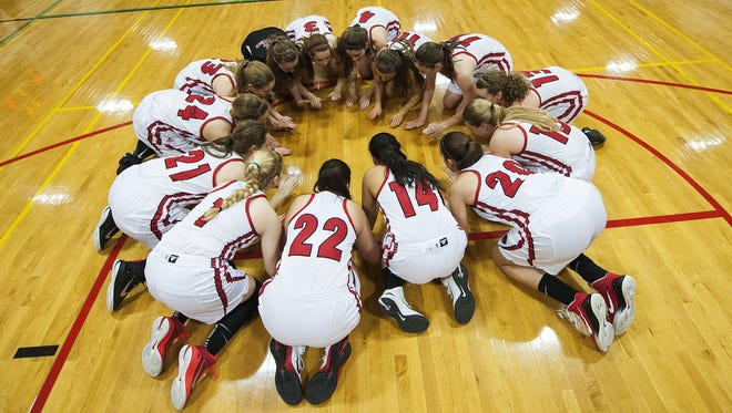 CVU huddles together before the opening tip off during a high school girls basketball game on Monday night.