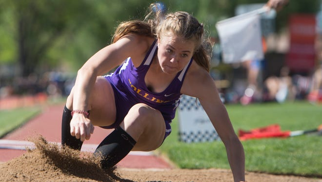 Kailey Paterson hits the sand during the triple jump finals in the CHSAA State Track and Field Championships at JeffCo Stadium in Lakewood on Thursday.