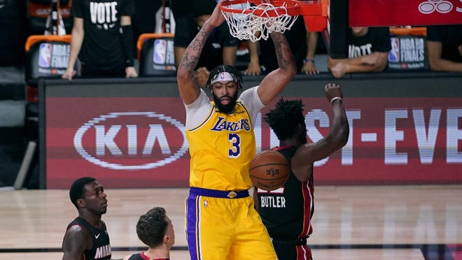 Los Angeles Lakers' Anthony Davis (3) slams a dunk against the Miami Heat during the second half of Game 1 of basketball's NBA Finals Wednesday, Sept. 30, 2020, in Lake Buena Vista, Fla.