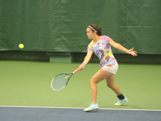 Annabelle Crowley lines up a forehand at the state tennis tournament in Madison on Oct. 13.