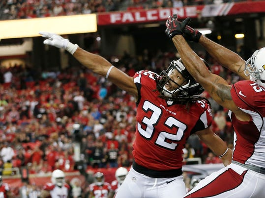 FILE - In this Nov. 27, 2016, file photo, Atlanta Falcons cornerback Jalen Collins (32) breaks up a pass intended for Arizona Cardinals wide receiver Michael Floyd (15) during a two-point conversion of an NFL football game, in Atlanta. The Atlanta Falcons' defense has new concerns after placing cornerback Desmond Trufant on injured reserve and also losing defensive end Adrian Clayborn to an injury. (AP Photo/John Bazemore, File)