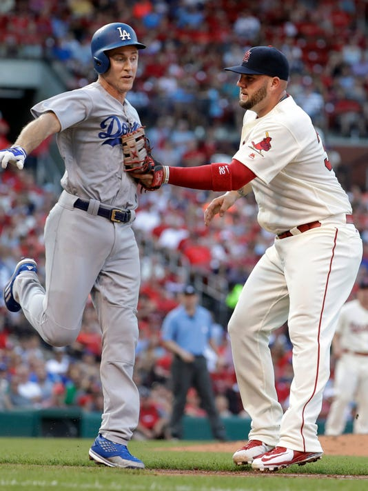 Los Angeles Dodgers' Chase Utley, left, is tagged out by St. Louis Cardinals first baseman Matt Adams during the third inning of a baseball game Saturday, July 23, 2016, in St. Louis. (AP Photo/Jeff Roberson)