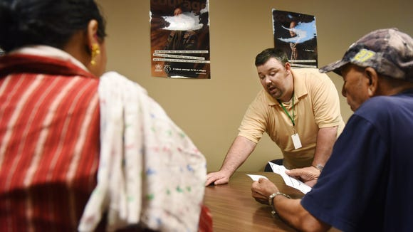 Eric Rippentrop volunteers to help teach english to new americans at Lutheran Social Services in downtown Sioux Falls.
