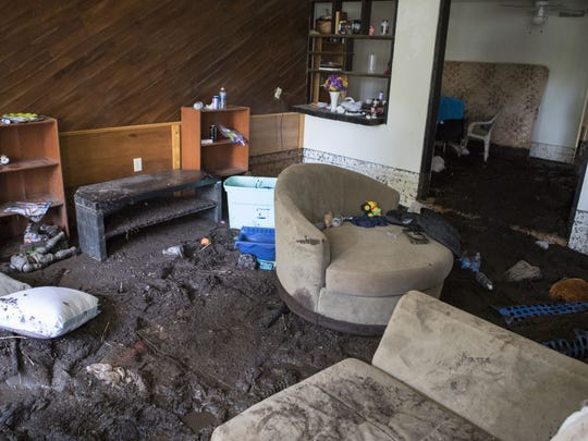 The inside of Dale Bennett's house is filled with mud on July 20, 2017, after a flood at Stagecoach Mobile Village in Mayer, Arizona.