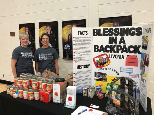 "Volunteering Tuesday at Livonia Churchill for ""Blessings in a Backpack"" were (from left) Colleen Drake and Denise Murray."