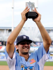 Infielder Nick Castellanos holds up the game MVP trophy after the 2012 All Star Futures Game at Kauffman Stadium.