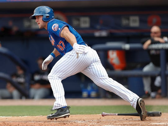 Tim Tebow rips a single Monday.