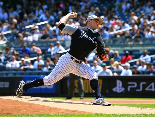 Yankees starter Sonny Gray delivers a pitch against