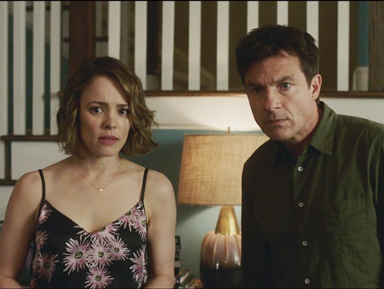 "Rachel McAdams and Jason Bateman star in ""Game Night."""