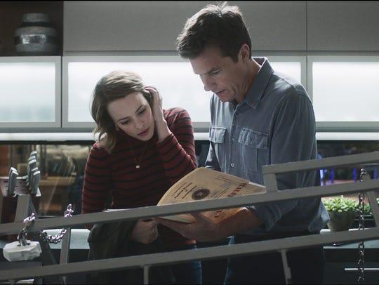 Rachel McAdams (left) and Jason Bateman try to find
