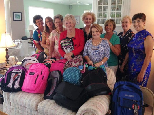 Nu Alpha donates backpacks for Devereaux