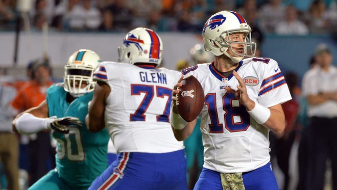 Buffalo Bills quarterback Kyle Orton (18) throws a pass against the Miami Dolphins during the first quarter at Sun Life Stadium.