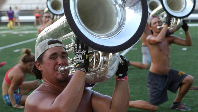 """Tuba player James """"Tiggy"""" Pollard, 20, plays with Louisiana Stars, a Drum and Bugle Corps, during rehearsal Tuesday for a show they will perform Thursday at Malone Stadium. The band will compete against other brass and drum corps in San Antonio this weekend. Their performance, called """"In Suspense,"""" combines music composed by 19th century Russian composers with music composed for films, including """"Ice Dance"""" by Tim Burton for the film """"Edward Scissorhands."""""""