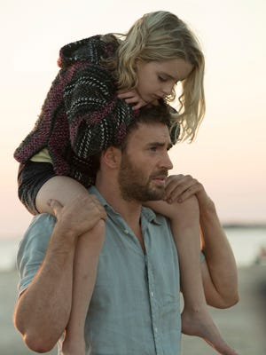 "McKenna Grace, left, and Chris Evans in a scene from ""Gifted."""