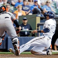 San Francisco Giants catcher Buster Posey tags out Milwaukee Brewers left fielder Khris Davis at home during the fourth inning of Wednesday's game.