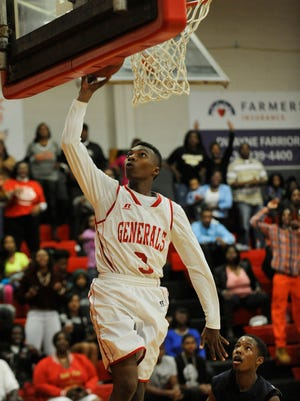 Lee's Roderic Scott (3) puts in a layup against Enterprise at Lee High School in Montgomery, Ala. on Saturday February 7, 2015.