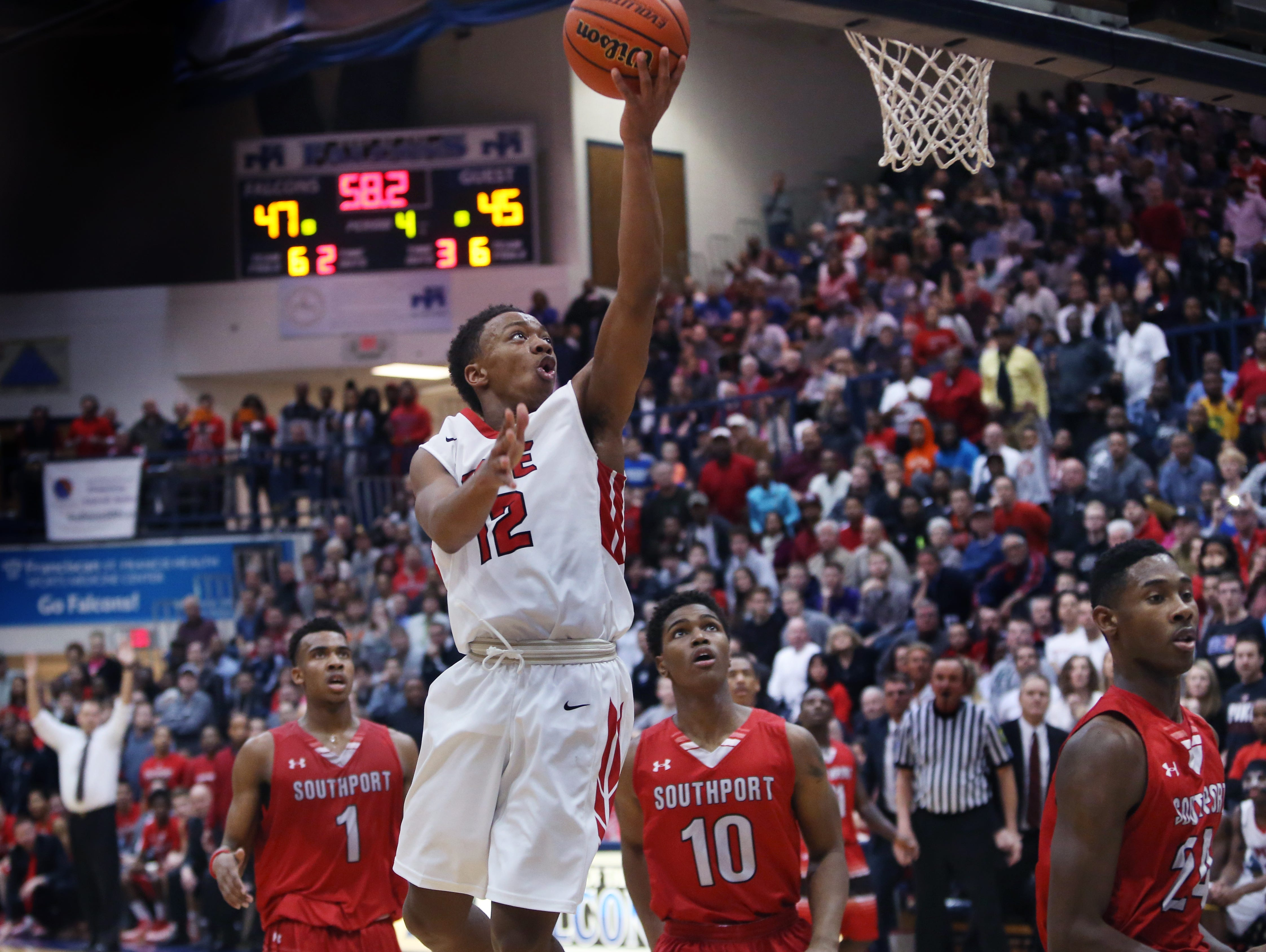 Pike Red Devil Justin Thomas, the team's high scorer with 21 points, makes an uncontested basket with under a minute to play, which turned out to be the winning basket, putting Pike ahead 49-45 in the teams' 49-48 win over the Class 4A No. 1 Southport Cardinals in the Perry Meridian boys basketball sectional final on Saturday, March 7, 2015.