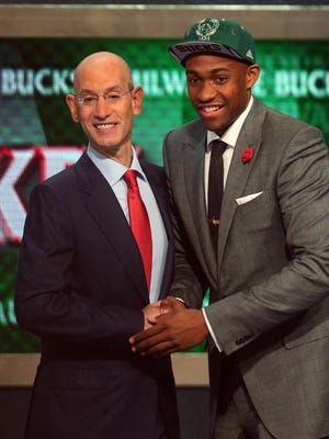NBA Commissioner Adam Silver shakes No. 2 overall draft pick Jabari Parker's hand Thursday.