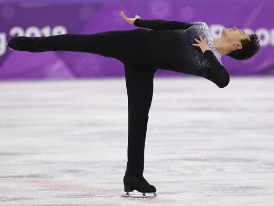 Patrick Chan of Canada performs during the men's short program figure skating in the Gangneung Ice Arena at the 2018 Winter Olympics in Gangneung, South Korea, Friday, Feb. 16, 2018. (AP Photo/David J. Phillip)