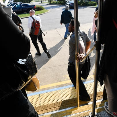 Passengers step off the Music City Star as they commute