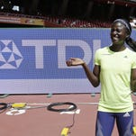 Sandhill native Tori Bowie celebrates after her third-place finish in the women?s 100m at the World Athletics Championships at the Bird?s Nest in Beijing in August..