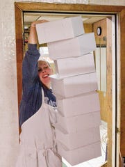 Ashley Bagazinski carries another load of boxes to the front of the bakery.