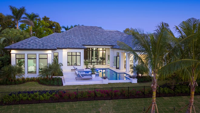 Calusa Bay Development and Knauf-Koenig Group have completed this custom home in Pelican Bay.