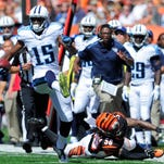 Justin Hunter, shown here running after a catch against the Cincinnati Bengals last season, enters his third year with the Tennessee Titans under pressure to play up to his potential, particularly after the team spent a second-round draft pick on Dorial Green-Beckham.