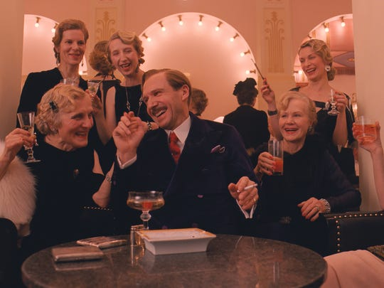 "Ralph Fiennes, center, in a scene from ""The Grand Budapest Hotel."""