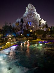 Guests on the Matterhorn Bobsleds scale the snowy summit