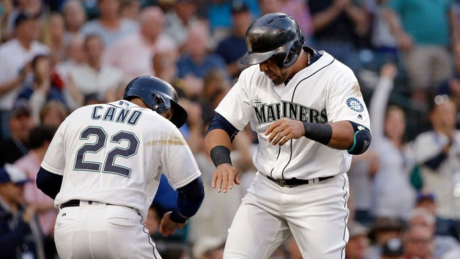 Seattle Mariners' Nelson Cruz, right, celebrates his two-run home run with Robinson Cano (22), during the fifth inning of a baseball game against the Pittsburgh Pirates on Tuesday, June 28, 2016, in Seattle.