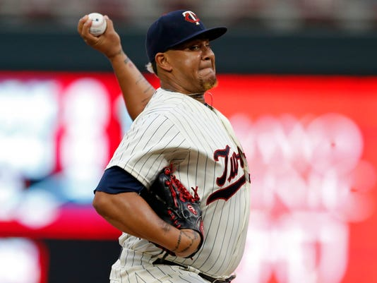 Minnesota Twins pitcher Adalberto Mejia throws against the Toronto Blue Jays in the first inning of a baseball game Saturday, Sept. 16, 2017, in Minneapolis. (AP Photo/Jim Mone)
